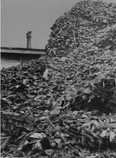 Piles of shoes stored in a warehouse in Auschwitz