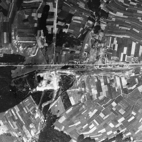 An aerial view of the Belzec area taken by the Luftwaffe during the war, which shows the camp and the rail lines leading to it. Circa 1944. Photo Credit: United States Holocaust Memorial Museum, courtesy of National Archives and Records Administration, College Park
