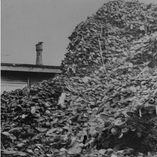 Piles of shoes stored in awarehouse in Auschwitz