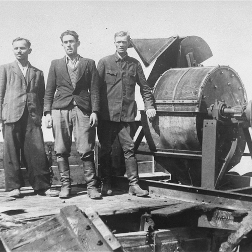 Jewish prisoners forced to work for a Sonderkommando 1005 unit pose next to a bone crushing machine in the Janowska concentration camp in Lvov, Poland. Circa Aug 1944. Photo Credit: United States Holocaust Memorial Museum, courtesy of Belarusian State Archive of Documentary Film and Photography