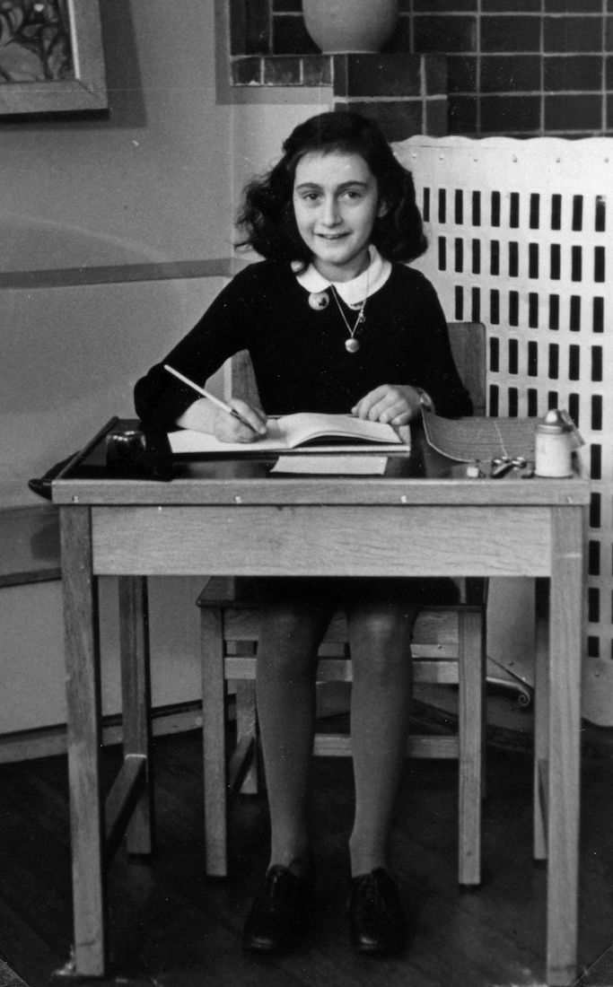 Anne Frank in 1940, while at 6. Montessorischool, Niersstrraat 41-43, Amsterdam (the Netherlands). Photograph by unknown photographer, via Wikimedia Commons.
