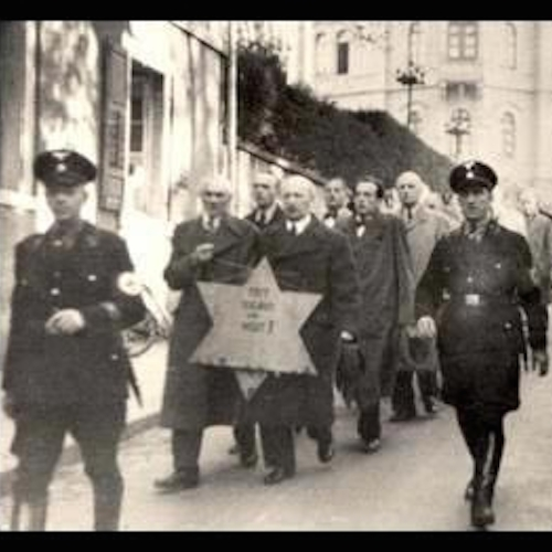 Jews being forced to walk with the star of David during the Kristallnacht in Nazi-Germany on the night of 9-10 November, 1938. See page for author [public domain], via Wikimedia Commons.